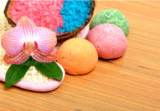 Spa accessories on wooden background. Spa accessories, bath bombs, sea salt, mop on wooden background Stock Images