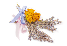 Spa Accessories, yellow dried roses with bunches of lavender Stock Photo