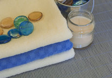 Spa accessory. Towels and candles on a woven mat (with focus on glass balls Stock Photos