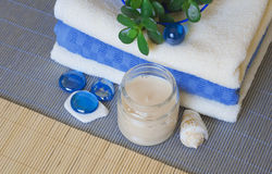 Spa accessory. Towels and candles on a woven mat Stock Photos