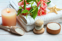 Spa accessory. Spa accessories: candle, sea salt and towel on wooden background Royalty Free Stock Images