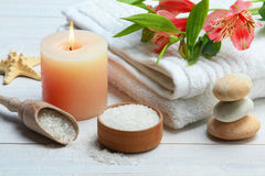 Spa accessory. Spa accessories: candle, sea salt and towel on wooden background Stock Photography