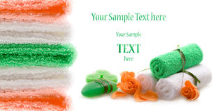 The spa advertising concept of green color. The towel, soap and candles over white background Royalty Free Stock Photos