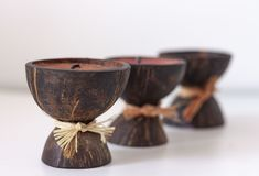 Spa aroma candles in coconut shell on a table royalty free stock photo