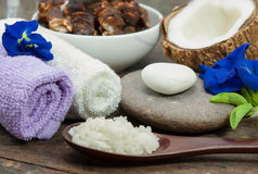 Spa Aroma Therapy. Towels, salt,scrub and flower in health spa for spa treatment Royalty Free Stock Photography