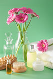 Spa aromatherapy with gerbera flowers essential oil brush Royalty Free Stock Images