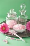 Spa aromatherapy with pink salt gerbera flowers Stock Image