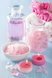 Spa aromatherapy with rose flowers perfume and herbal salt Stock Photos