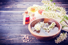 Spa aromatherapy set. Flowers, massage oil, sea salt Royalty Free Stock Images