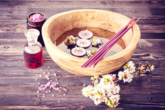 Spa aromatherapy set. Incense, candles, essential oils and flowers for spa treatments and body care Stock Photography