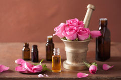Spa and aromatherapy set with rose flowers mortar essential oils Royalty Free Stock Image