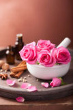 Spa and aromatherapy set with rose flowers mortar and spices Stock Photo