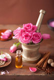 Spa and aromatherapy set with rose flowers mortar and spices Royalty Free Stock Image