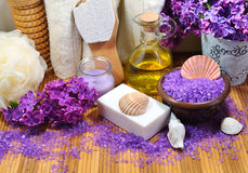 SPA - Aromatic sea salt and scented soap, scented candles and massage oil and accessories for massage and bath royalty free stock image
