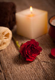 Red rose and white candle Royalty Free Stock Images