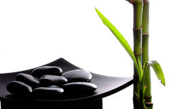 Spa atmosphere. Bamboo and zen stones isolated on white Stock Images