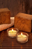 SPA atmosphere with two candles with light and soap Stock Image