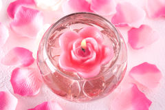 Spa background. A rose candle in a bowl with water an petals around Stock Images