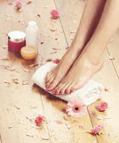 Spa background with beautiful feet, flowers and petals Stock Photography