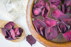 Spa background with beautiful rose petals and a clay bowl. Stock Photography