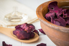 Spa background with beautiful rose petals and a clay bowl. Royalty Free Stock Photography