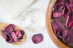Spa background with beautiful rose petals and a clay bowl. Royalty Free Stock Photo
