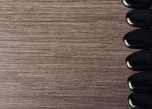 Free Spa Background. Black Stones On Wooden Royalty Free Stock Photos - 27400028