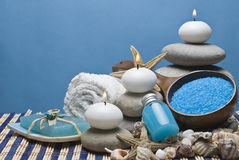 Spa background in blue. Spa background with some hygiene items and zen balanced stones Royalty Free Stock Photo