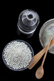 Spa background with Clay in pieces ready ingredient for mask and skincare treatment on black Royalty Free Stock Photo