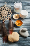 Spa background with cosmetics bottles, stones and lit candles Royalty Free Stock Photography