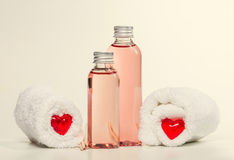 Spa background with erotic massage oil and towels. Royalty Free Stock Image