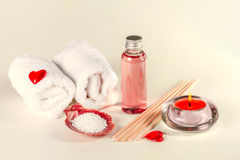 Spa background with erotic massage oil and towels. Stock Photo