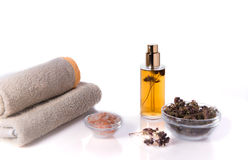 Spa background. Oregano and sea salt, towels and candles. Dried herbs. Stock Images