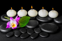 Spa background of row white candles, orchid flower dendrobium an Stock Photo