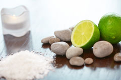 Spa Background. Sea Salt with Lime Stones and Candle . Body scru Royalty Free Stock Photography