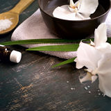 Spa background with white orchid in bowl of water. Space for tex Stock Photo