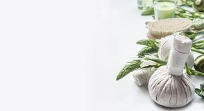 Free Spa Background With Massage Herbal Balls , Green Herbs And Flowers On White. Beauty, Healthy Body Care Stock Photo - 116536170