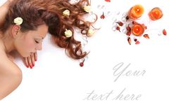 Spa banner. Beautiful long-haired girl relaxing in spa salon Royalty Free Stock Images