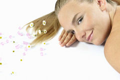 Spa banner. Beautiful long-haired girl relaxing in spa salon. looking at camera Stock Photo