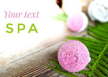Spa bath ball with fern leaf on wooden background. royalty free stock photography
