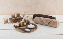 Spa and Bath Essentials with Candlelight. Spa and bath essentials, including handmade artisan soap and body scrub, with candlelight Royalty Free Stock Photography