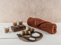 Spa and Bath Essentials Natural Earth Tones. Spa and bath essentials, including handmade artisan soap and body scrub, in natural earth tones Royalty Free Stock Images