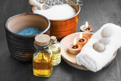 Spa bath oils with scent candles and sea salt Stock Photo