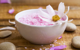 Spa bath salt bowl with flower.Pink bath salt wellness compositi Stock Image