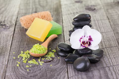 Spa with bath salt, soaps, loofah and black stones Stock Photo