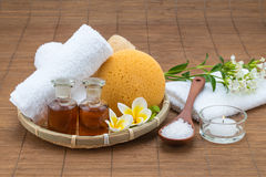 Spa bath, salt spoon, candle towel sponge essential oil and flow Stock Photography