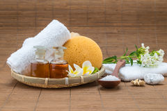 Spa bath, salt spoon, towel sponge essential oil and flower for Stock Images