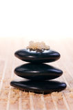 Spa bath salt on a stack of balance zen stones Stock Photography
