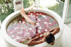 Spa bathing with flowers Royalty Free Stock Photos