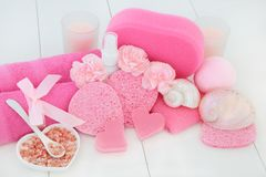 Spa and Bathroom Accessories. Spa and bathroom beauty treatment accessories with pink carnation flowers, himalayan ex foliating salt, heart shaped soaps, body Stock Photo